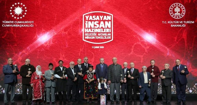 President Recep Tayyip Erdoğan M poses with prize winners at the ceremony.  AA Photo