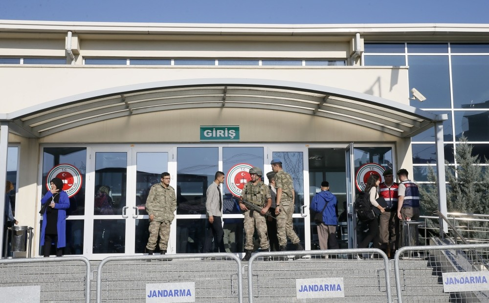 Soldiers stand guard outside a courthouse in Istanbul's Silivri district where pro-coup soldiers accused of killing 34 people are being tried.