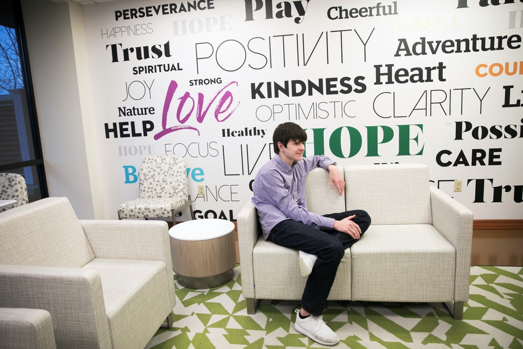 Danny Reagan, a former patient of the Lindner Center of Hope's ,Reboot, program, first of its kind to admit only children who suffer from compulsion or obsession with their use of technology, sits in a common room at the center in Mason,Ohio, Jan.23.