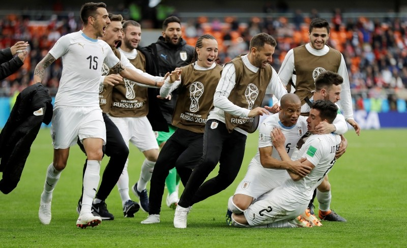 Uruguay's Jose Gimenez, bottom right, celebrates with his teammates after scoring his side's opening goal during the World Cup Group A match between Egypt and Uruguay in the Yekaterinburg Arena in Yekaterinburg, Russia, June 15, 2018. (AP Photo)