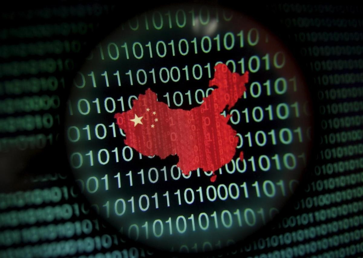 A map of China is seen through a magnifying glass on a computer screen showing binary digits in Singapore in this January 2, 2014 file photo illustration. (REUTERS Photo)