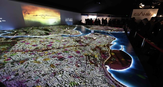 Visitors look at a scale model of Istanbul at the Palais des Festivals in Cannes, at MIPIM, March 16, 2016.