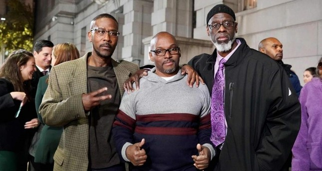 (From L to R) Alfred Chesnut, Andrew Stewart and Ransom Watkins pose for a photo after their liberation in Baltimore on Nov. 25, 2019. (Photo by Todd Kimmelman/MIAP/AFP)
