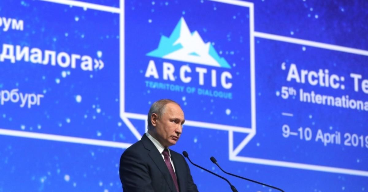 Russian President Vladimir Putin gives a speech during the International Arctic Forum in Saint Petersburg on April 9, 2019. (Photo by Mikhail KLIMENTYEV / SPUTNIK / AFP)