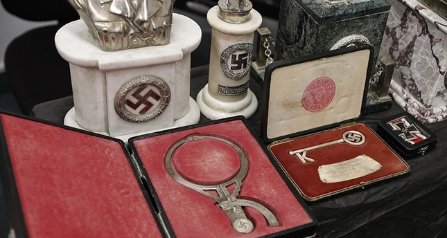 Detail of artifacts bearing Nazi symbols that were recovered by the Argentine Federal Police (PFA), displayed at the headquarters of the Delegation of Argentinean Israeli Associations in Buenos Aires, Argentina, 19 June 2017. (EPA Photo)