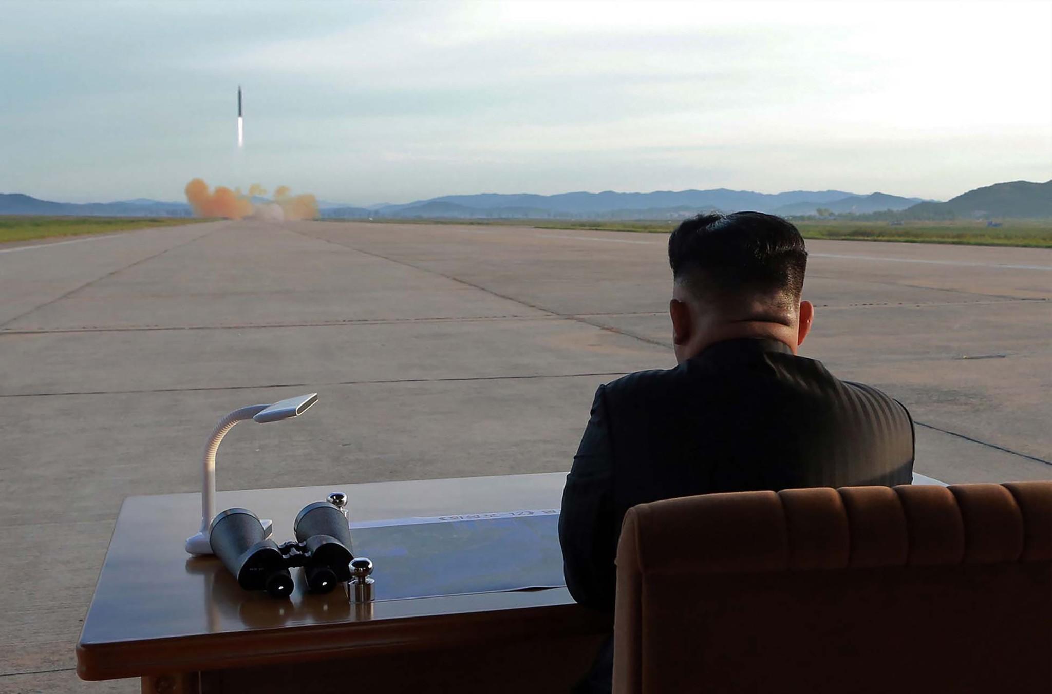 North Korean leader Kim Jong Un inspectes a launching drill of the medium-and-long range strategic ballistic rocket Hwasong-12 at an undisclosed location, Sept. 16.