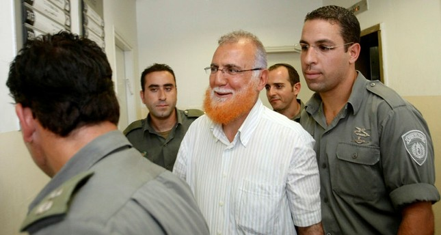 Palestinian lawmaker Mohammed Abu Teir, center, is escorted into a courtroom  in Jerusalem, Monday, July 12, 2010. (AP Photo)