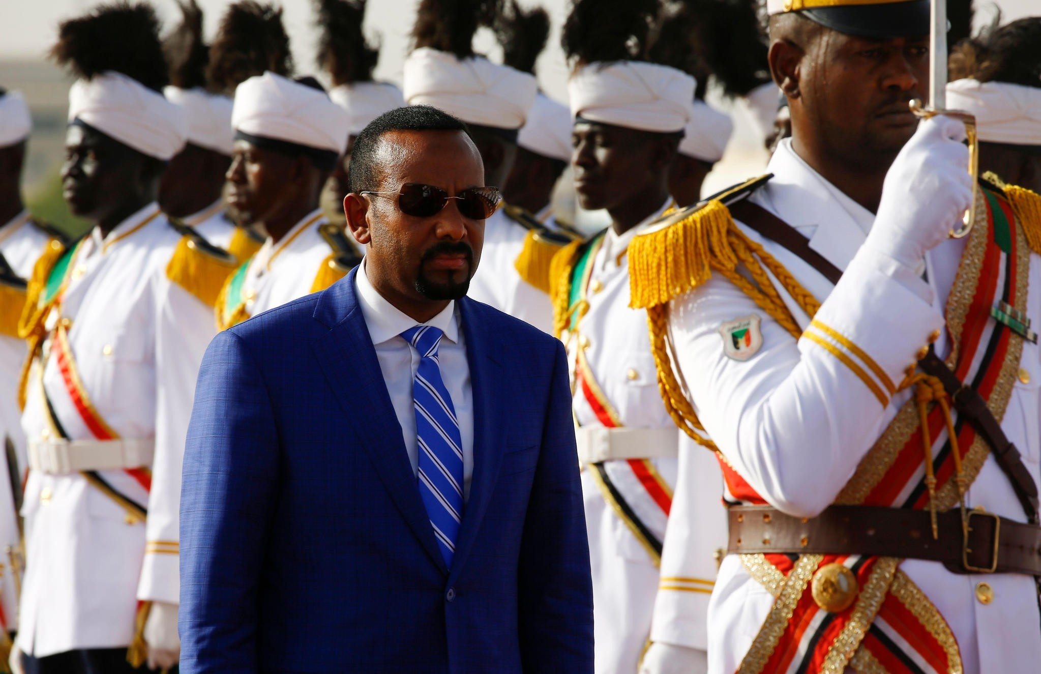 Ethiopian Prime Minister Abiy Ahmed reviews the honour guard following his arrival in Khartoum for an official visit to Sudan on May 2, 2018.