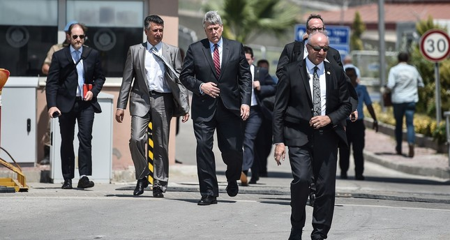 U.S. Charge d'Affairs Philip Kosnett, third from left, leaves after the trial of U.S. Pastor Andrew Brunson who has been detained in Turkey for over a year on terrorism charges, Aliağa, İzmir, July 18.