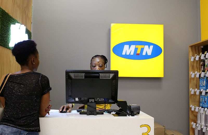 This file photo shows a worker attending to a customer at an MTN shop at mall in Johannesburg, South Africa, March 2, 2017. (Reuters Photo)