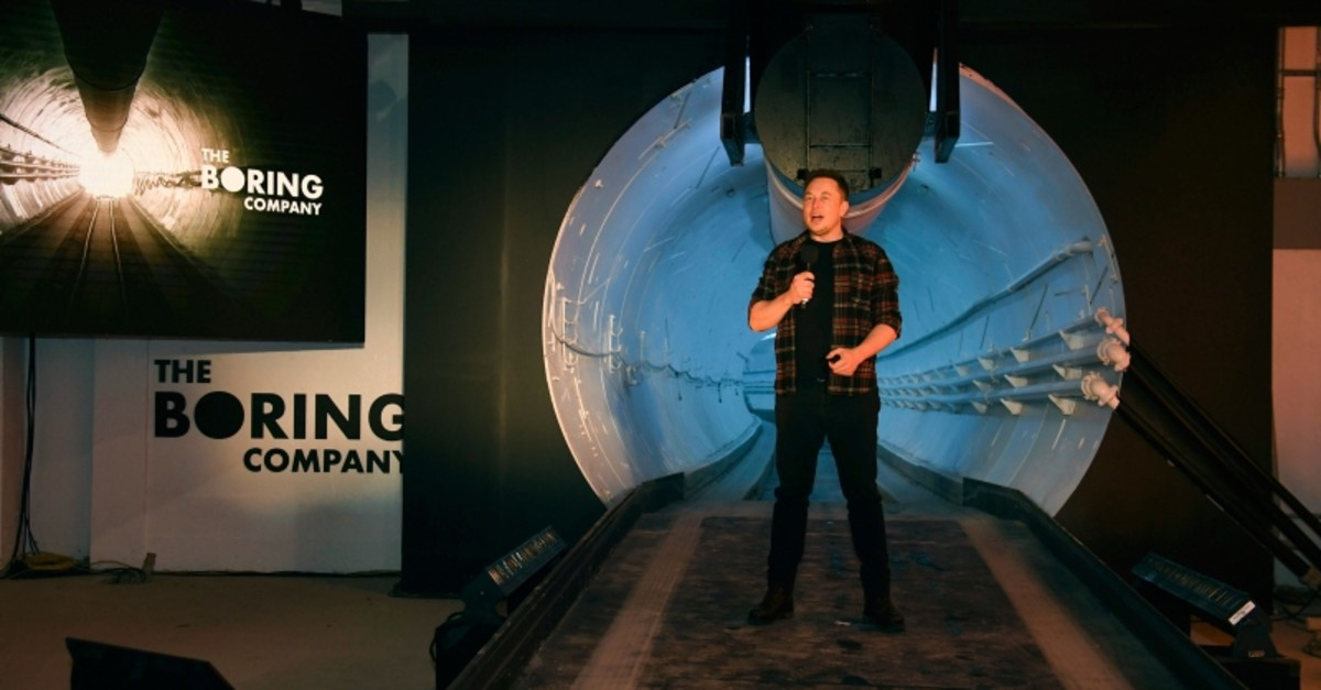 In this Dec. 18, 2018 file photo Elon Musk, co-founder and chief executive officer of Tesla Inc., speaks during an unveiling event for the Boring Co. Hawthorne test tunnel in Hawthorne, Calif. (AP Photo)