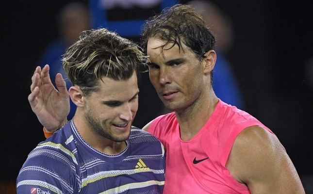Austria's Dominic Thiem L is congratulated by Spain's Rafael Nadal after winning their quarterfinal match at the Australian Open tennis championship in Melbourne, Australia, Wednesday, Jan. 29, 2020. AP Photo