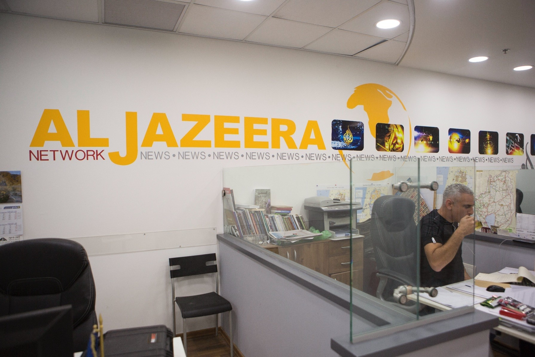 An employee of the Al-Jazeera satellite channel work at the Qatari media networku2019s Jerusalem bureau, Israel, June 14.