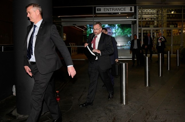 Australian Federal Police (AFP) investigators leave the main entrance to the ABC building located at Ultimo in Sydney, Australia. (Reuters Photo)