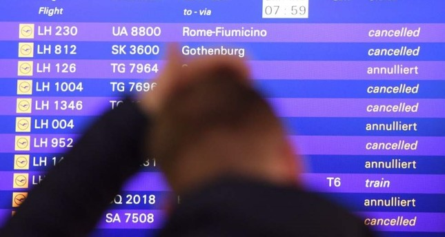 A passenger stands in front of the departure board at the airport in Frankfurt, Germany, Friday, Nov. 25, 2016. (AP Photo)
