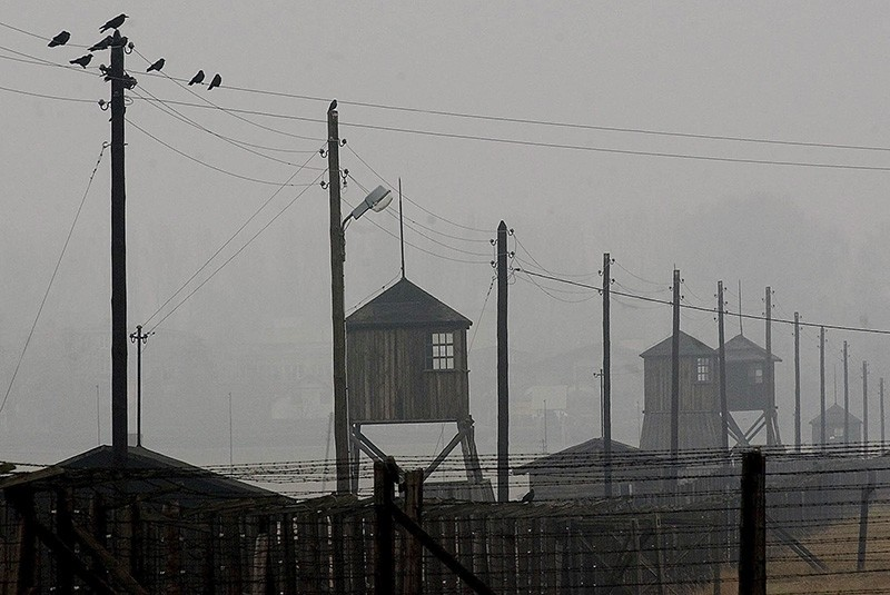 In this Nov. 9, 2005 file photo watch towers and the barbed wire fence of the former Nazi death camp Majdanek are photographed  outside the city of Lublin in eastern Poland. (AP Photo)