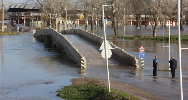 A bridge partially submerged during a flood caused by overflow of the River Tunca (Tundzha) in Edirne province of Turkey on March 27, 2018. (IHA Photo)