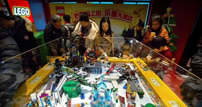 People look at a display of Lego creations at Hamley's toy store durıng its grand opening in Beijing, Saturday, Dec. 23, 2017. (AP Photo)