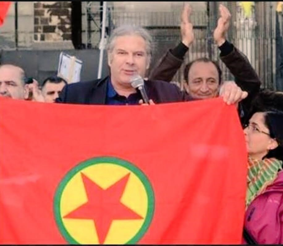 German lawmaker Andrej Hunko seen carrying the PKK flag at a pro-PKK rally in this file photo
