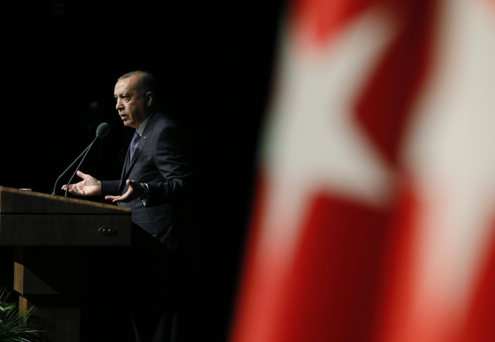 President Erdou011fan speaks about the Khashoggi murder, asking some unanswered questions regarding the case in order to help find the people responsible for the killing, at a symposium in Ankara, Oct. 24.