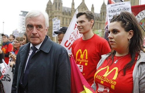 Britain's opposition Labour party's Shadow Chancellor of the Exchequer John McDonnell (L), attends a protest against working conditions and the use of zero-hour contracts at British outlets of US burger chain McDonalds, in central London on September 4, 2017