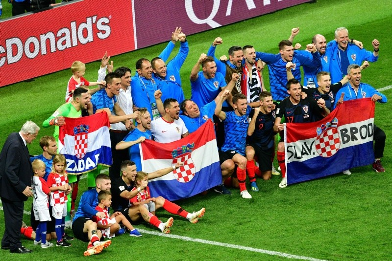 Croatia's players celebrate after winning the Russia 2018 World Cup semi-final football match between Croatia and England at the Luzhniki Stadium in Moscow on July 11, 2018. (AFP Photo)