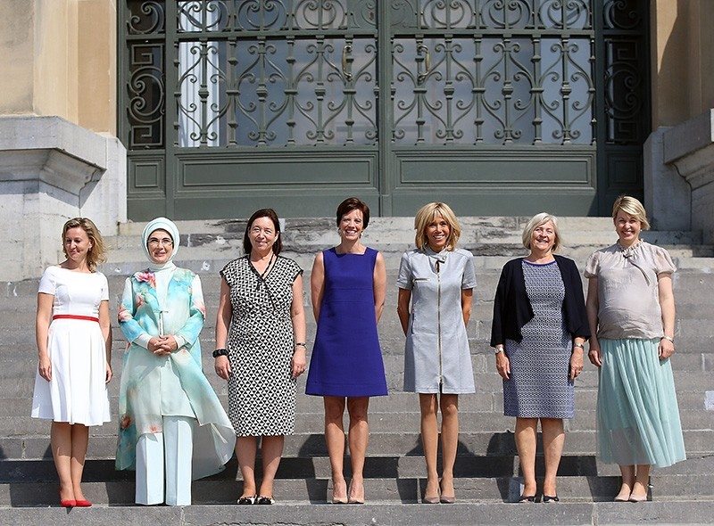 A group photo of NATO first ladies outside the museum