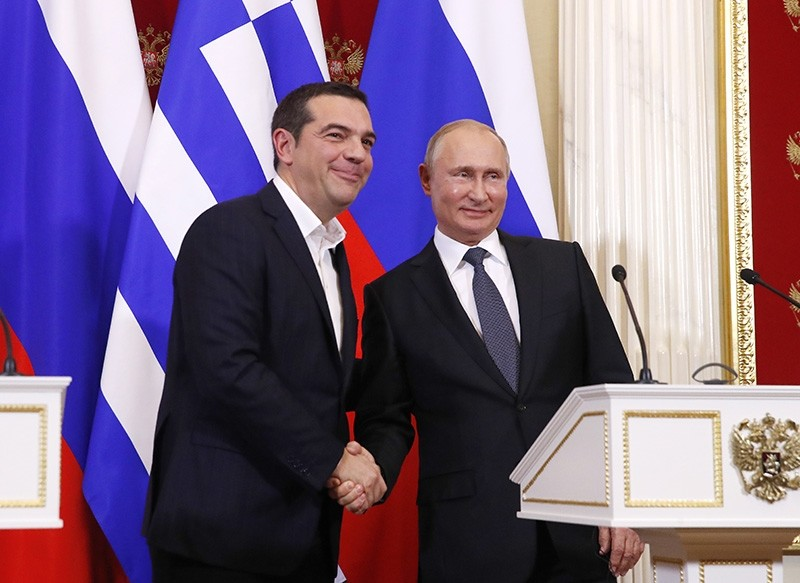 Greek Prime Minister Alexis Tsipras (L) shakes hands with Russian President Vladimir Putin (R) during a joint news conference following their talks at the Kremlin in Moscow, Russia, Dec. 7, 2018. (EPA Photo)