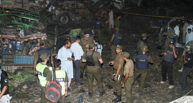 Pakistani security personnel visit the site of a blast in Lahore, Pakistan, Monday, Aug. 7, 2017. (AP Photo)