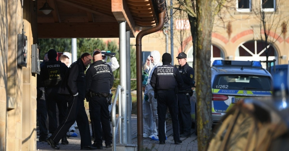 German police, including forensic experts stand at the entrance of a house after a shooter, believed to have a personal motive, launched an assault on January 24, 2020 in the town of Rot am See in southwestern Germany. (AFP Photo)