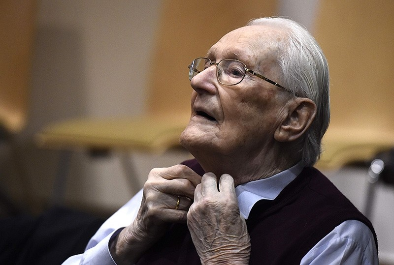 In this file photo taken on July 15, 2015 Convicted former SS officer Oskar Groening listens to the verdict of his trial at court in Lueneburg, northern Germany. (AFP Photo)