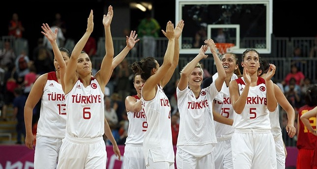 Players celebrate victory against China after their women's preliminary round Group A basketball match at the Basketball Arena during London 2012 Olympic Games Reuters