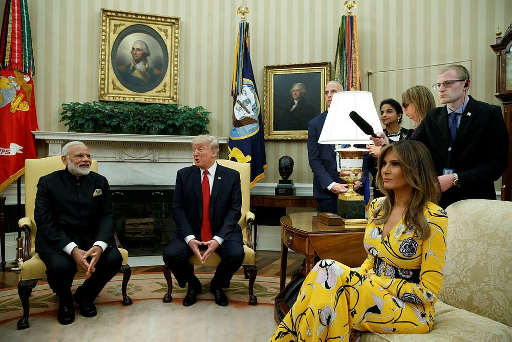 Melania Trump is wearing a yellow floral Pucci dress at a meeting with Indian Prime Minister Narendra Modi.   (AP Photo)