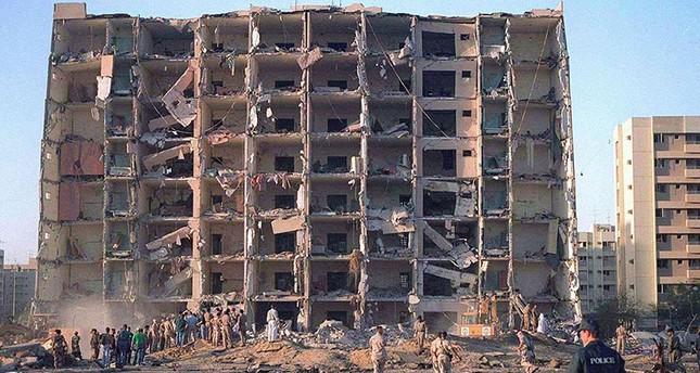 Investigators inspect the Khobar Towers military complex after an attack in Khobar, Saudi Arabia in June 1996. (Reuters Photo)