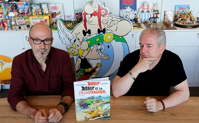 Author Jean-Yves Ferri (L) and illustrator Didier Conrad stand next to a copy of their new comic album Asterix et la Transitalique (Asterix and the Chariot Race) during an interview in Vanves near Paris, France, October 17, 2017. (Reuters Photo)