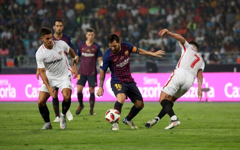 Barcelona's Argentinian forward Lionel Messi, center, vies for the ball with Sevilla players during the Spanish Super Cup final at Ibn Batouta Stadium in Tangiers, Morocco, Aug. 12, 2018. (AFP Photo)
