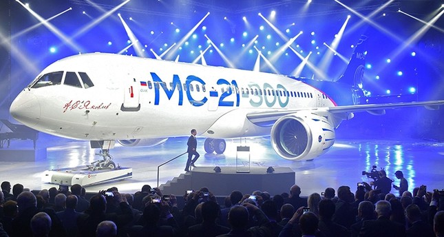 In this file photo taken on June 8, 2016, Russian Prime Minister Dmitry Medvedev arrives to give a speech in front of the new MC-21 medium-haul airliner during the roll-out ceremony at an aircraft plant in Irkutsk. (AFP Photo)