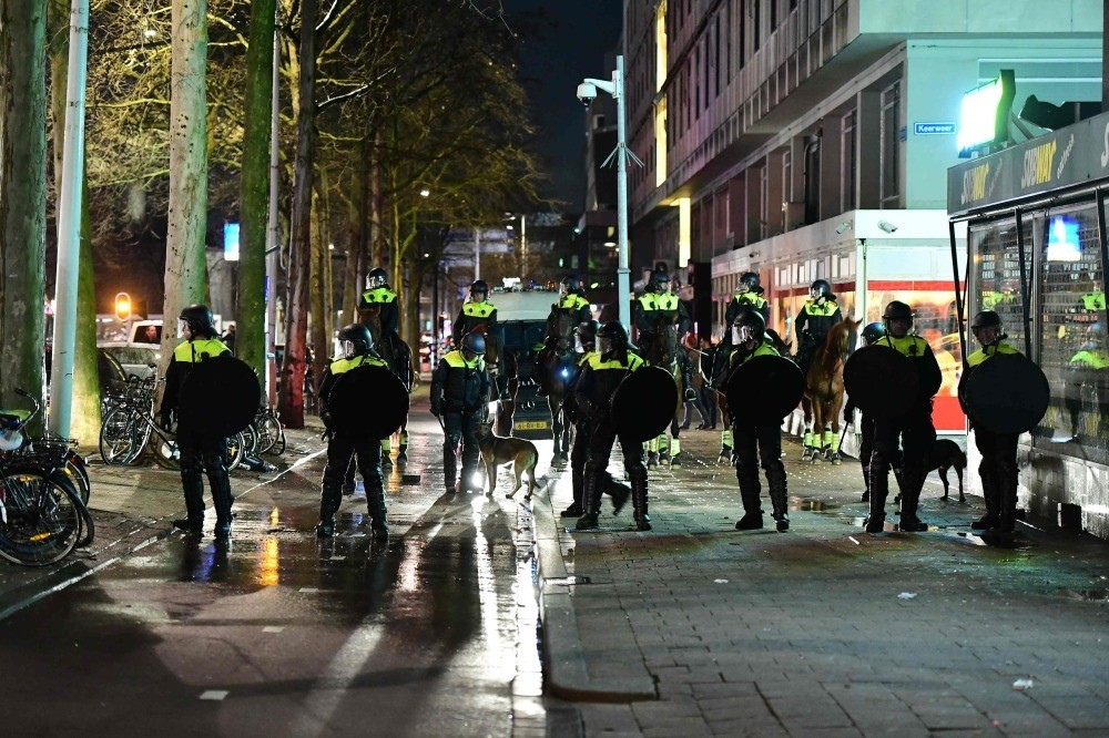 Dutch police standing on streets during clashes with demonstrators protesting Dutch government's treatment of Turkey's Family and Social Policies Minister Fatma Betu00fcl Sayan Kaya, blocking her from entering Turkish Consulate in Rotterdam, March 12.