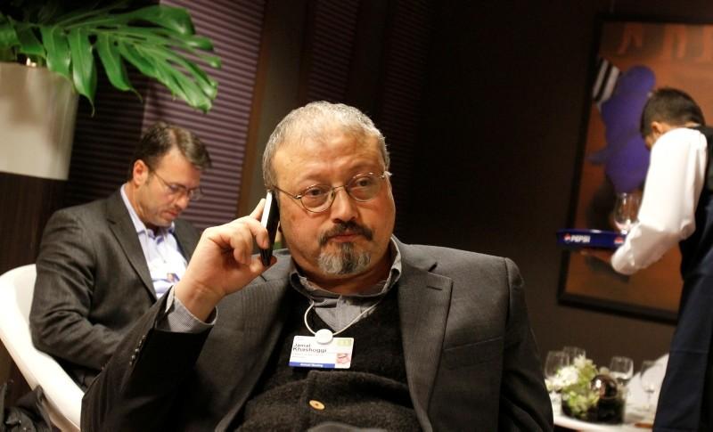 In this Jan. 29, 2011, file photo, Saudi Arabian journalist Jamal Khashoggi speaks on his cellphone at the World Economic Forum in Davos, Switzerland. (AP Photo)