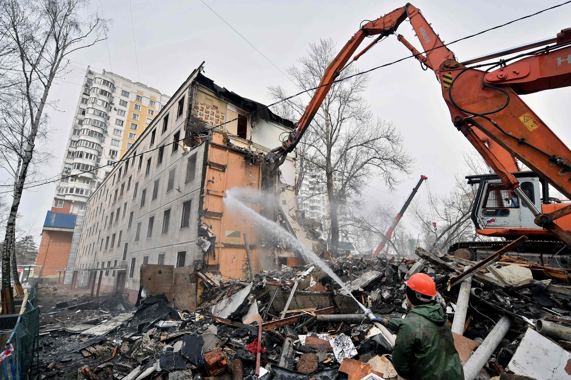 An excavator demolishes a five-storey apartment block in Moscow. City authorities headed by Kremlin-backed Moscow mayor Sergei Sobyanin initiated the vast program - due to start in September - to knock down low-rise housing.