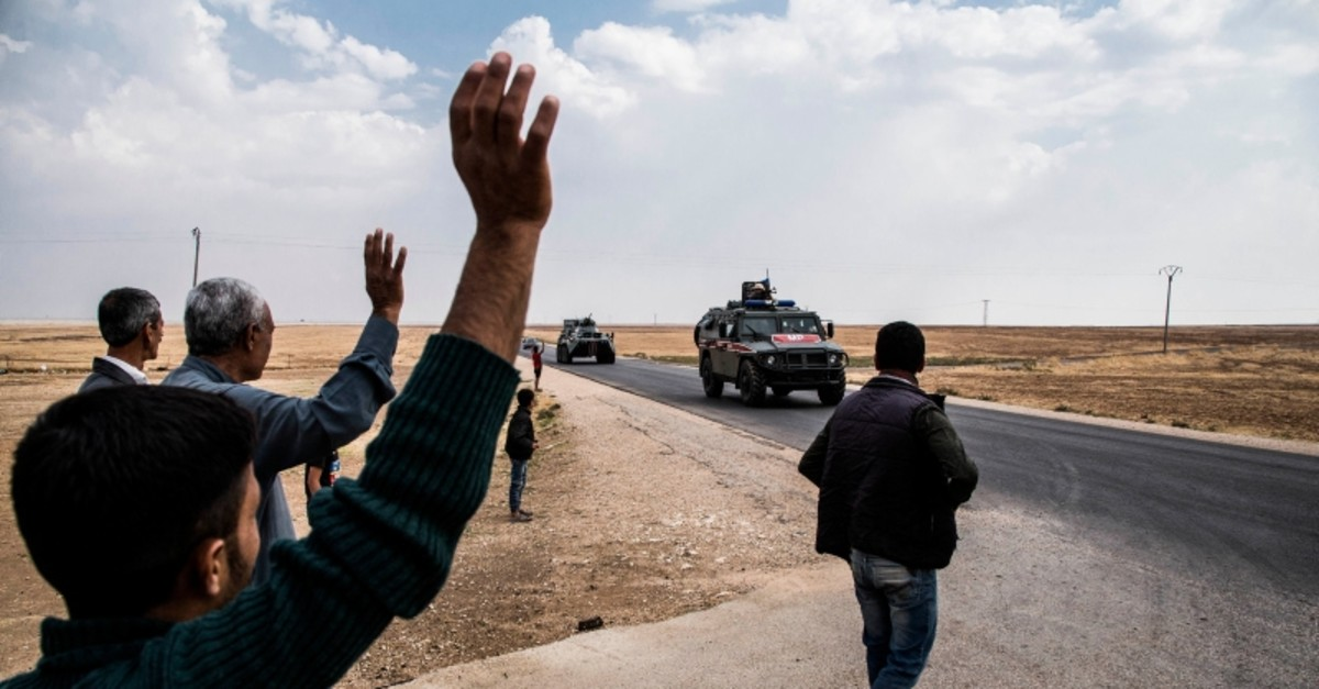 Russian military patrols near Syrian and Turkish border in north Syria, Friday. Oct. 25, 2019. (AP Photo)