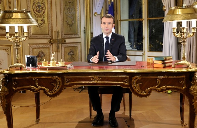French President Emmanuel Macron poses before a special address to the nation, his first public comments after four weeks of nationwide yellow vest protests, at the Élysée Palace in Paris, Dec. 10.