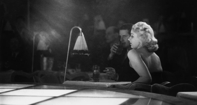 "9th December 1950: A couple sitting next to the stage for a floor show at ""La Nouvelle Eve,"" the newest and most expensive night spot in Paris."