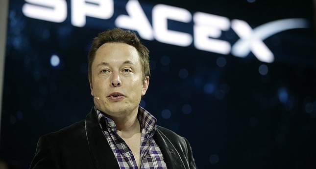 Elon Musk, CEO and CTO of SpaceX, introduces the SpaceX Dragon V2 spaceship at the SpaceX headquarters in Hawthorne, California. (AP Photo)