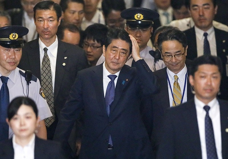Japanese Prime Minister Shinzo Abe (C), surrounded by parliamentary guards and security agents, walks in a corridor after leaving a special parliamentary committee at the Lower House in Tokyo, Japan, July 24, 2017. (EPA Photo)