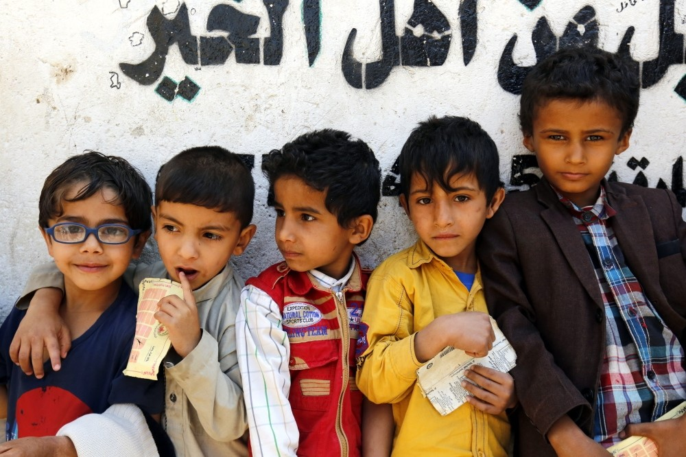 Conflict-affected children wait to receive their families' free food rations from a local charity, Sanaa, Nov. 3.