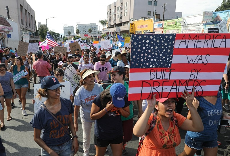 Immigrants-rights protesters demonstrate against the policies of US president Donald J. Trump's administration while marching in Los Angeles, California, USA, 10 September 2017. (EPA Photo)