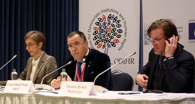 The OSCE's ODIHR mission head in Turkey Tana de Zulueta (L), ODIHR and the PACE Cezar Florin Preda (C) and ODIHR Spokesman Thomas Rymer (R) giving a press conference in Ankara following the results in the constitutional referendum, April 17.