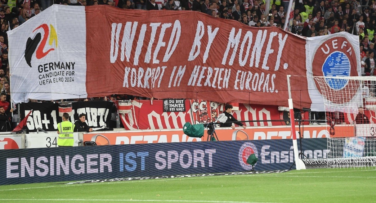 Stuttgart fans hold up supporters display a giant banner reading u201cUnited by money, corrupt in the heart of Europeu201d to protest against Germanyu2019s candidacy for Euro 2024 during a Bundesliga match, Sept. 21.