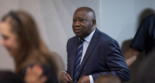 Former Ivory Coast President Laurent Gbagbo enters the courtroom of the International Criminal Court in The Hague, Netherlands, Tuesday, Jan. 15, 2019. (AP Photo)